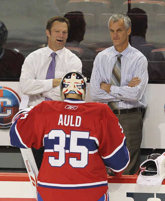 MONTREAL, QC - SEPTEMBER 24: Assistant Coach Kirk Muller speaks with Alex Auld #35 of the Montreal Canadiens prior to the game against the Ottawa Senators at the Bell Centre on September 24, 2010 in Montreal, Canada. The Canadiens defeated the Senators 4-