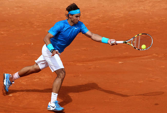 PARIS, FRANCE - MAY 30:  Rafael Nadal of Spain plays a forehand during the men's singles round four match between Rafael Nadal of Spain and Ivan Lubicic of Croatia on day nine of the French Open at Roland Garros on May 30, 2011 in Paris, France.  (Photo b