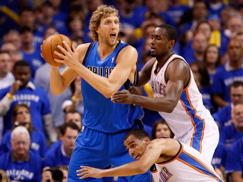 OKLAHOMA CITY, OK - MAY 23:  Dirk Nowitzki #41 of the Dallas Mavericks looks to pass the ball as he is double-teammed by Serge Ibaka #9 and Thabo Sefolosha #2 of the Oklahoma City Thunder in the first half in Game Four of the Western Conference Finals dur