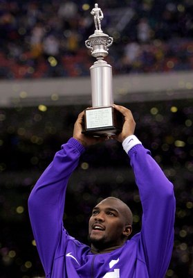 NEW ORLEANS - JANUARY 03:   Quarterback JaMarcus Russell #2 of the LSU Tigers holds up the MVP trophy after his team defeating the Notre Dame Fighting Irish in the 2007 Allstate Sugar Bowl on January 3, 2007 at the Superdome in New Orleans, Louisiana.  LS