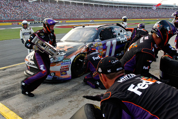 CONCORD, NC - MAY 29: Denny Hamlin, driver of the #11 FedEx Express Toyota, pits during the NASCAR Sprint Cup Series Coca-Cola 600 at Charlotte Motor Speedway on May 29, 2011 in Concord, North Carolina.  (Photo by Geoff Burke/Getty Images for NASCAR)