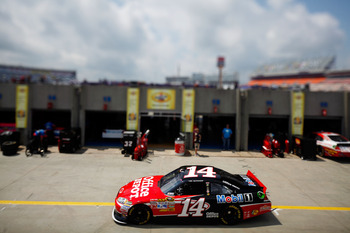 CHARLOTTE, NC - MAY 28:  (***EDITORS NOTE*** - THIS DIGITAL IMAGE WAS CREATED WITH THE USE OF VARIABLE FOCAL PLANE LENS) Tony Stewart drives the #14 Office Depot/Mobil 1 Chevrolet through the garage area during practice for the NASCAR Sprint Cup Series Co