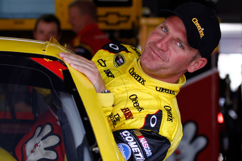 CHARLOTTE, NC - MAY 28:  Clint Bowyer, driver of the #33 Cheerios/Hamburger Helper Chevrolet, climbs in his car during practice for the NASCAR Sprint Cup Series Coca-Cola 600 at Charlotte Motor Speedway on May 28, 2011 in Charlotte, North Carolina.  (Phot