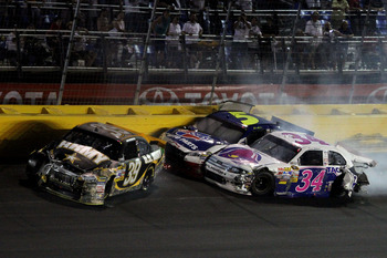 CONCORD, NC - MAY 29:  Ryan Newman, driver of the #39 U.S. Army Chevrolet, David Gilliland, driver of the #34 Taco Bell Ford, and Mark Martin, driver of the #5 Carquest/GoDaddy.com Chevrolet, hit the wall after an incidnet in the NASCAR Sprint Cup Series