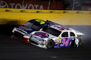 CONCORD, NC - MAY 29:  David Gilliland, driver of the #34 Taco Bell Ford, and Mark Martin, driver of the #5 Carquest/GoDaddy.com Chevrolet, collide after hitting the wall during the NASCAR Sprint Cup Series Coca-Cola 600 at Charlotte Motor Speedway on May