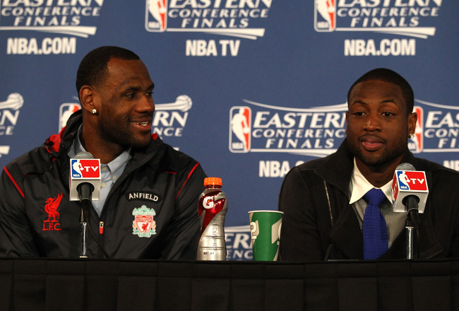CHICAGO, IL - MAY 26: (L-R) LeBron James #6 and Dwyane Wade of the Miami Heat answers questions from the media at the post game press conference after the Heat won 83-80 against the Chicago Bulls in Game Five of the Eastern Conference Finals during the 20