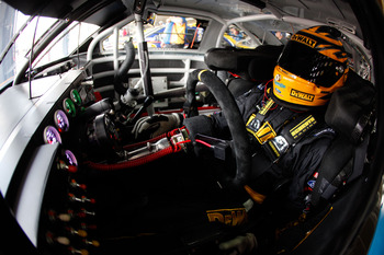 CHARLOTTE, NC - MAY 28:  Marcos Ambrose, driver of the #9 Dewalt Ford, sits in his car during practice for the NASCAR Sprint Cup Series Coca-Cola 600 at Charlotte Motor Speedway on May 28, 2011 in Charlotte, North Carolina.  (Photo by Chris Graythen/Getty