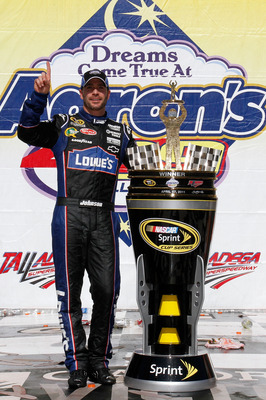 TALLADEGA, AL - APRIL 17:  Jimmie Johnson, driver of the #48 Lowe's Chevrolet, poses in Victory Lane after winning the NASCAR Sprint Cup Series Aaron's 499 at Talladega Superspeedway on April 17, 2011 in Talladega, Alabama.  (Photo by Jason Smith/Getty Im