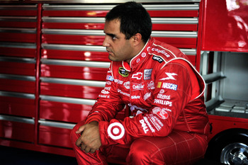 CHARLOTTE, NC - MAY 28:  Juan Pablo Montoya, driver of the #42 Target Chevrolet, sits in the garage during practice for the NASCAR Sprint Cup Series Coca-Cola 600 at Charlotte Motor Speedway on May 28, 2011 in Charlotte, North Carolina.  (Photo by Jason S