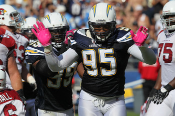 SAN DIEGO - OCTOBER 03:  Linebackers Shaun Phillips #95 and Kevin Burnett #99 of the San Diego Chargers celebrate a Phillips sack against the Arizona Cardinals at Qualcomm Stadium on October 3, 2010 in San Diego, California.   The Chargers won 41-10.  (Ph