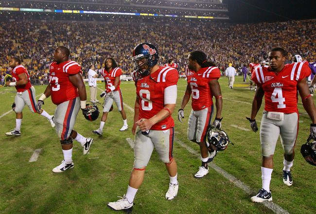 BATON ROUGE, LA - NOVEMBER 20:  Quarterback Jeremiah Masoli #8 of the Ole Miss Rebels walks off the field after their 43-36 loss to the Louisiana State University Tigers at Tiger Stadium on November 20, 2010 in Baton Rouge, Louisiana.  (Photo by Kevin C.