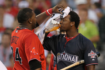 ANAHEIM, CA - JULY 12:  American League All-Star David Ortiz #34 of the Boston Red Sox towels off National League All-Star Hanley Ramirez #2 of the Florida Marlins after the final round of the 2010 State Farm Home Run Derby during All-Star Weekend at Ange