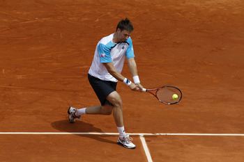 PARIS, FRANCE - MAY 26:  Robin Soderling of Sweden plays a backhand during the men's singles round two match between Albert Ramos of Spain and Robin Soderling of Sweden on day five of the French Open at Roland Garros on May 26, 2011 in Paris, France.  (Ph