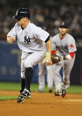 NEW YORK, NY - MAY 15:  Brett Gardner #11 of the New York Yankees is caught in a run down against the Boston Red Sox during their game on May 15, 2011 at Yankee Stadium in the Bronx borough of New York City.  (Photo by Al Bello/Getty Images)