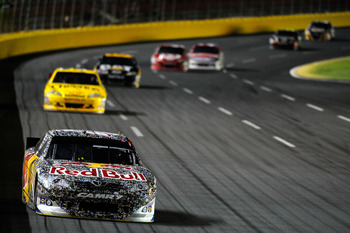 CONCORD, NC - MAY 29:  Kasey Kahne, driver of the #4 Red Bull Toyota, leads the field during the NASCAR Sprint Cup Series Coca-Cola 600 at Charlotte Motor Speedway on May 29, 2011 in Concord, North Carolina.  (Photo by Jared C. Tilton/Getty Images for NAS