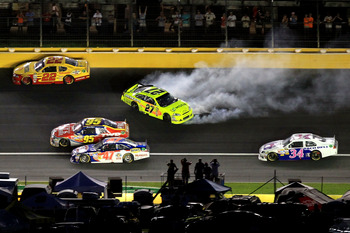 CONCORD, NC - MAY 29:  Paul Menard, driver of the #27 Moen/Menards Chevrolet, spins out during the NASCAR Sprint Cup Series Coca-Cola 600 at Charlotte Motor Speedway on May 29, 2011 in Concord, North Carolina.  (Photo by Streeter Lecka/Getty Images)