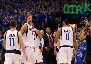 DALLAS, TX - MAY 25:  Dirk Nowitzki #41 of the Dallas Mavericks looks over at teammate Jose Juan Barea #11 late in the fourth quarter while taking on the Oklahoma City Thunder in Game Five of the Western Conference Finals during the 2011 NBA Playoffs at A