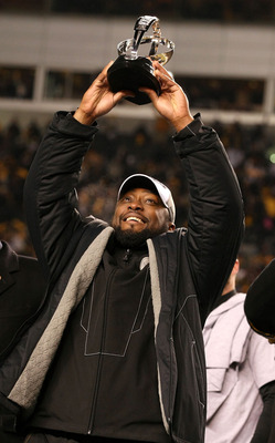 PITTSBURGH, PA - JANUARY 23:  Head coach Mike Tomlin of the Pittsburgh Steelers holds up the Lamar Hunt trophy after the Steelers defeated the New York Jets 24 to 19 in the 2011 AFC Championship game at Heinz Field on January 23, 2011 in Pittsburgh, Penns