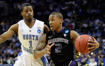 CHARLOTTE, NC - MARCH 20:  Isaiah Thomas #2 of the Washington Huskies drives on Dexter Strickland #1 of the North Carolina Tar Heels during the third round of the 2011 NCAA men's basketball tournament at Time Warner Cable Arena on March 20, 2011 in Charlo