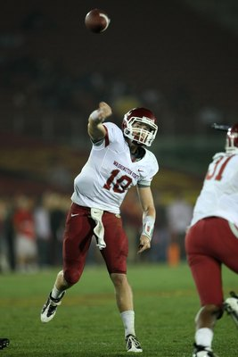 LOS ANGELES, CA - SEPTEMBER 26:  Quarterback Jeff Tuel #10 of the Washington State Cougars throws a pass against the USC Trojans on September 23, 2009 at the Los Angeles Coliseum in Los Angeles, California.  USC won 27-6.  (Photo by Stephen Dunn/Getty Ima