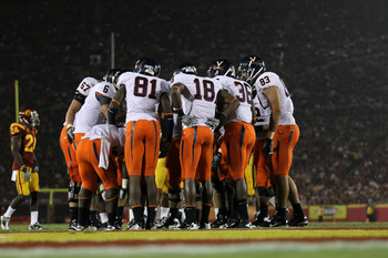 LOS ANGELES - SEPTEMBER 11:  The Virginia Cavaliers offense huddles with their backs to their goal line against the USC Trojans at Los Angeles Memorial Coliseum on September 11, 2010 in Los Angeles, California. (Photo by Stephen Dunn/Getty Images)