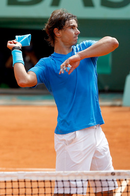 PARIS, FRANCE - MAY 30:  Rafael Nadal of Spain throws his sweatband into the crowd following his victory during the men's singles round four match between Rafael Nadal of Spain and Ivan Lubicic of Croatia on day nine of the French Open at Roland Garros on