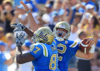 PASADENA, CA - OCTOBER 02:  Quarterback Richard Brehaut #12 of the UCLA Bruins celebrates a touchdown with teammate Cory Harkey #87 against the Washington State Cougars during the game at the Rose Bowl on October 2, 2010 in Pasadena, California. UCLA defe