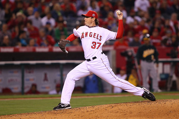 ANAHEIM, CA - MAY 23:  Scott Downs #37 of the Los Angeles Angeles of Anaheim pitches in the eighth inning during the game against the Oakland Athletics at Angel Stadium on May 23, 2011 in Anaheim, California.  (Photo by Joe Scarnici/Getty Images)