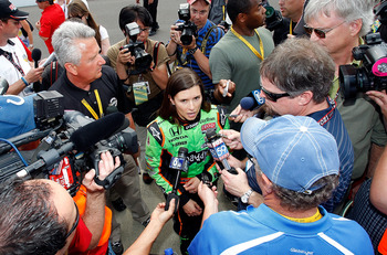 INDIANAPOLIS - MAY 22: Danica Patrick driver of the #7 Team GoDaddy Andretti Autosport Dallara Honda talks with the media after qualifying for the the 95th Indianapolis 500 Mile Race at the Indianapolis Motor Speedway on May 22, 2011 in Indianapolis, Indi