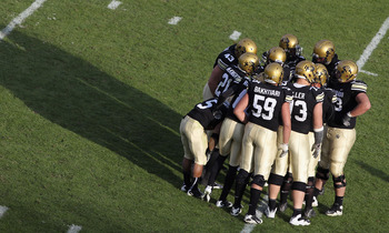 BOULDER, CO - NOVEMBER 20:  The Colorado Buffaloes offenses huddles up against the Kansas State Wildcats at Folsom Field on November 20, 2010 in Boulder, Colorado. Colorado defeated Kansas State 44-36.  (Photo by Doug Pensinger/Getty Images)