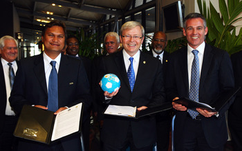 CAIRNS, AUSTRALIA - AUGUST 05:  (L-R) President of the Oceania Football Confederation Reynald Temarii, Australian Prime Minister Kevin Rudd and CEO of Football Australia Ben Buckley pose after signing a joint agreement at the Pacific Island Leaders Forum
