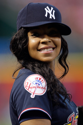 ST LOUIS, MO - JULY 12:  Singer Ashanti takes part in the Taco Bell All-Star Legends & Celebrity Softball Game at Busch Stadium on July 12, 2009 in St. Louis, Missouri.  (Photo by Jamie Squire/Getty Images)