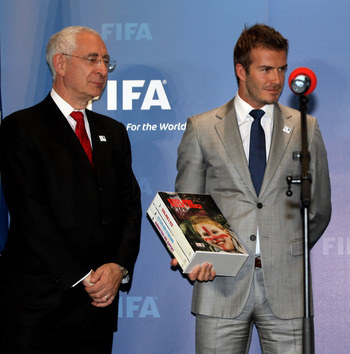 ZURICH, SWITZERLAND - MAY 14: Lord Triesman, Chairman, England 2012 and  David Beckham, England 2018 Vice President prepare to hand over the Bid book to Sepp Blatter, President of FIFA during the 2018/2022 World Cup Bid Book Handover ceremony at FIFA Head