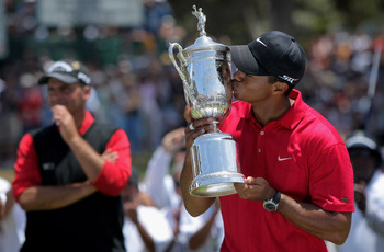 SAN DIEGO - JUNE 16:  Tiger Woods celebrates with the trophy after winning on the first sudden death playoff hole during the playoff round of the 108th U.S. Open at the Torrey Pines Golf Course (South Course) on June 16, 2008 in San Diego, California. Run