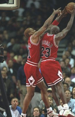25 Nov 1996:  Chicago Bulls guard Michael Jordan (right) and forward Dennis Rodman go up for a rebound during a game against the Los Angeles Clippers at the Sports Arena in Los Angeles, California.  The Bulls won the game, 88-84.     Mandatory Credit: J.