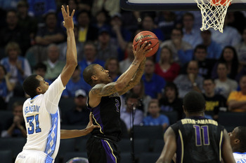 CHARLOTTE, NC - MARCH 20:  Isaiah Thomas #2 of the Washington Huskies goes up for a shot in front of John Henson #31 of the North Carolina Tar Heels in the second half during the third round of the 2011 NCAA men's basketball tournament at Time Warner Cabl