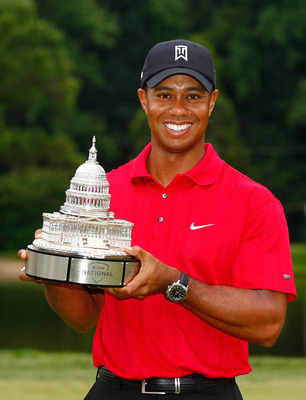 BETHESDA, MD - JULY 05:  Tiger Woods poses with the trophy after his one-stroke victory at the AT&T National at the Congressional Country Club on July 5, 2009 in Bethesda, Maryland.  (Photo by Scott Halleran/Getty Images)