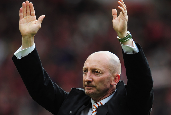 MANCHESTER, ENGLAND - MAY 22:  A dejected Ian Holloway manager of Blackpool salutes the fans as Blackpool are relegated after the Barclays Premier League match between Manchester United and Blackpool at Old Trafford on May 22, 2011 in Manchester, England.