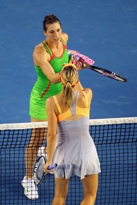 MELBOURNE, AUSTRALIA - JANUARY 23:  Andrea Petkovic of Germany is congratulated by Maria Sharapova of Russia after winning her fourth round match during day seven of the 2011 Australian Open at Melbourne Park on January 23, 2011 in Melbourne, Australia.