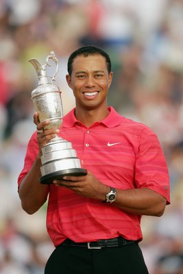 HOYLAKE, UNITED KINGDOM - JULY 23:  Tiger Woods of USA poses with the claret jug following his two shot victory at the end of the final round of The Open Championship at Royal Liverpool Golf Club on July 23, 2006 in Hoylake, England.  (Photo by Andrew Red