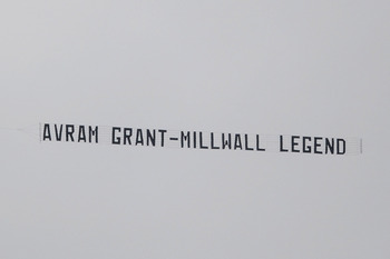 WIGAN, ENGLAND - MAY 15: An aircraft tows a banner above the stadium mocking West Ham Manager Avram Grant during the Barclays Premier League match between Wigan Athletic and West Ham United at the DW Stadium on May 15, 2011 in Wigan, England. (Photo by Ch