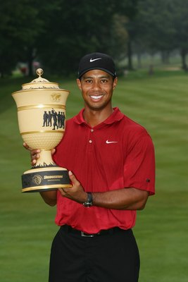 AKRON, OH - AUGUST 05: Tiger Woods holds the trophy after winning the WGC-Bridgestone Invitational on August 5, 2007 at Firestone Country Club in Akron, Ohio.  (Photo by Sam Greenwood/Getty Images)