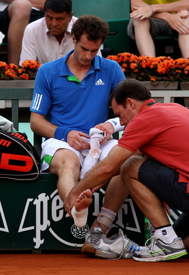 PARIS, FRANCE - MAY 30:  Andy Murray of Great Britain receives treatment on his injured ankle during the men's singles round four match between Andy Murray of Great Britain and Victor Troicki of Serbia on day nine of the French Open at Roland Garros on Ma