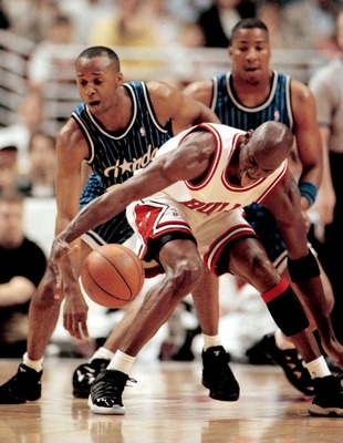 14 MAY 1995:  CHICAGO BULLS GUARD MICHAEL JORDAN REGAINS CONTROL OF THE BALL AS ORLANDO MAGIC GUARD BRIAN SHAW ATTEMPTS TO COME IN FOR THE STEAL DURING FIRST HALF ACTION OF GAME FOUR IN THE EASTERN CONFERENCE SEMIFINAL MATCHUP AT THE UNITED CENTER IN CHIC