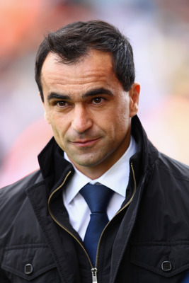 STOKE ON TRENT, ENGLAND - MAY 22:  Manager Roberto Martinez of Wigan walks onto the pitch ahead of the Barclays Premier League match between Stoke City and Wigan Athletic at Britannia Stadium on May 22, 2011 in Stoke on Trent, England.  (Photo by Richard