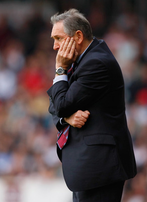 LONDON, ENGLAND - APRIL 16:  Aston Villa manager Gerard Houllier looks thoughtful during the Barclays Premier League match between West Ham United and Aston Villa at the Boleyn Ground on April 16, 2011 in London, England.  (Photo by Tom Dulat/Getty Images