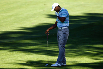 PARAMUS, NJ - AUGUST 27:  Tiger Woods hangs his head as he reacts to his shot from the fairway on the sixth hole during the second round of The Barclays at the Ridgewood Country Club on August 27, 2010 in Paramus, New Jersey.  (Photo by Scott Halleran/Get