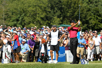 NORTON, MA - SEPTEMBER 06:  Tiger Woods tees off on the third hole during the final round of the Deutsche Bank Championship at TPC Boston on September 6, 2010 in Norton, Massachusetts.  (Photo by Mike Ehrmann/Getty Images)