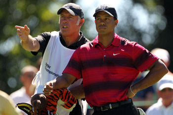 LEMONT, IL - SEPTEMBER 12:  Caddie Steve Williams and Tiger Woods talk over a shot on the sixth hole during the final round of the BMW Championship at Cog Hill Golf & Country Club on September 12, 2010 in Lemont, Illinois.  (Photo by Jamie Squire/Getty Im