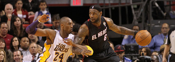 MIAMI, FL - MARCH 10:  LeBron James #6 of the Miami Heat posts up Kobe Bryant #24 of  the Los Angeles Lakers  during a game at American Airlines Arena on March 10, 2011 in Miami, Florida. NOTE TO USER: User expressly acknowledges and agrees that, by downl